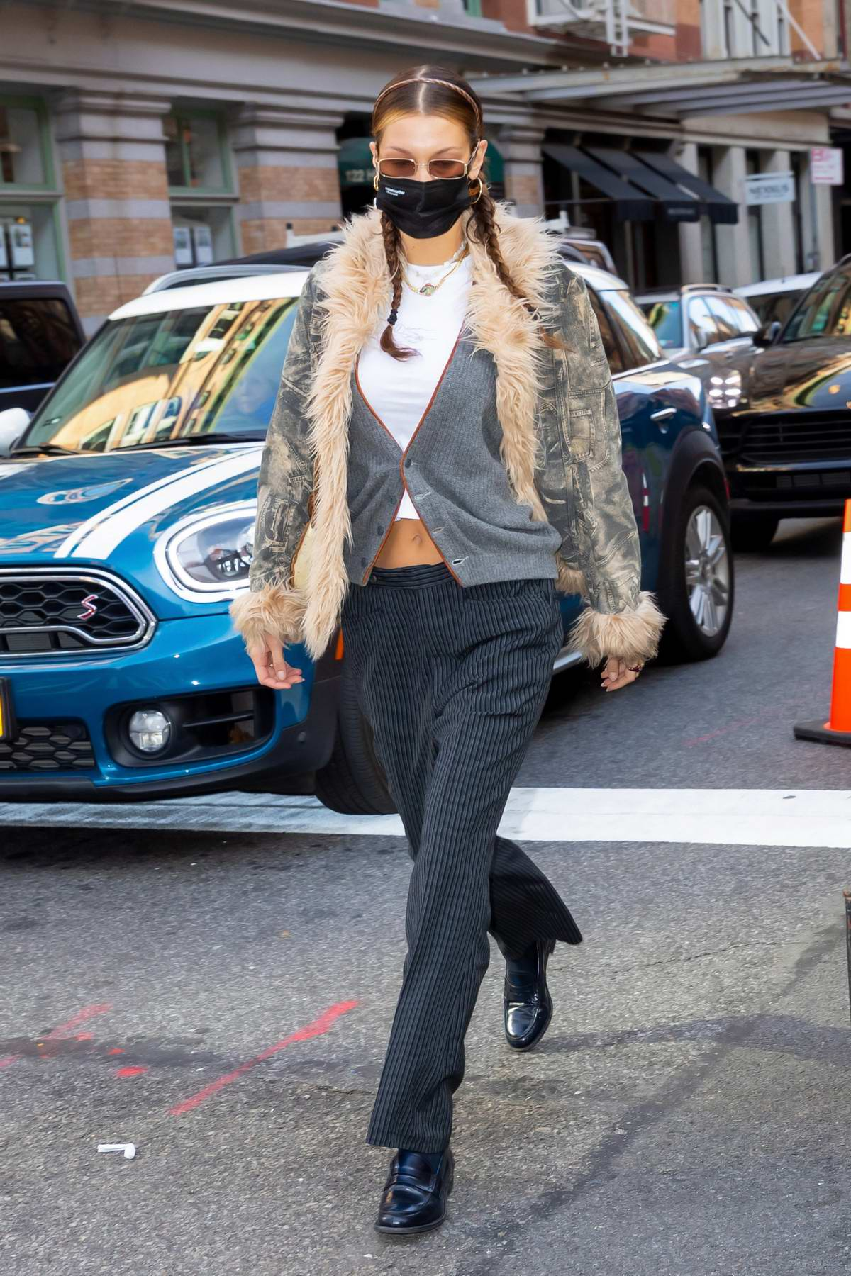 Bella Hadid rocks a fur-lined jacket while out for lunch with Kendall Jenner at Bubby's in Tribeca, New York City