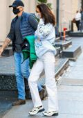 Bella Hadid rocks a light blue sweatshirt and white pants as she arrives back to her apartment in SoHo, New York