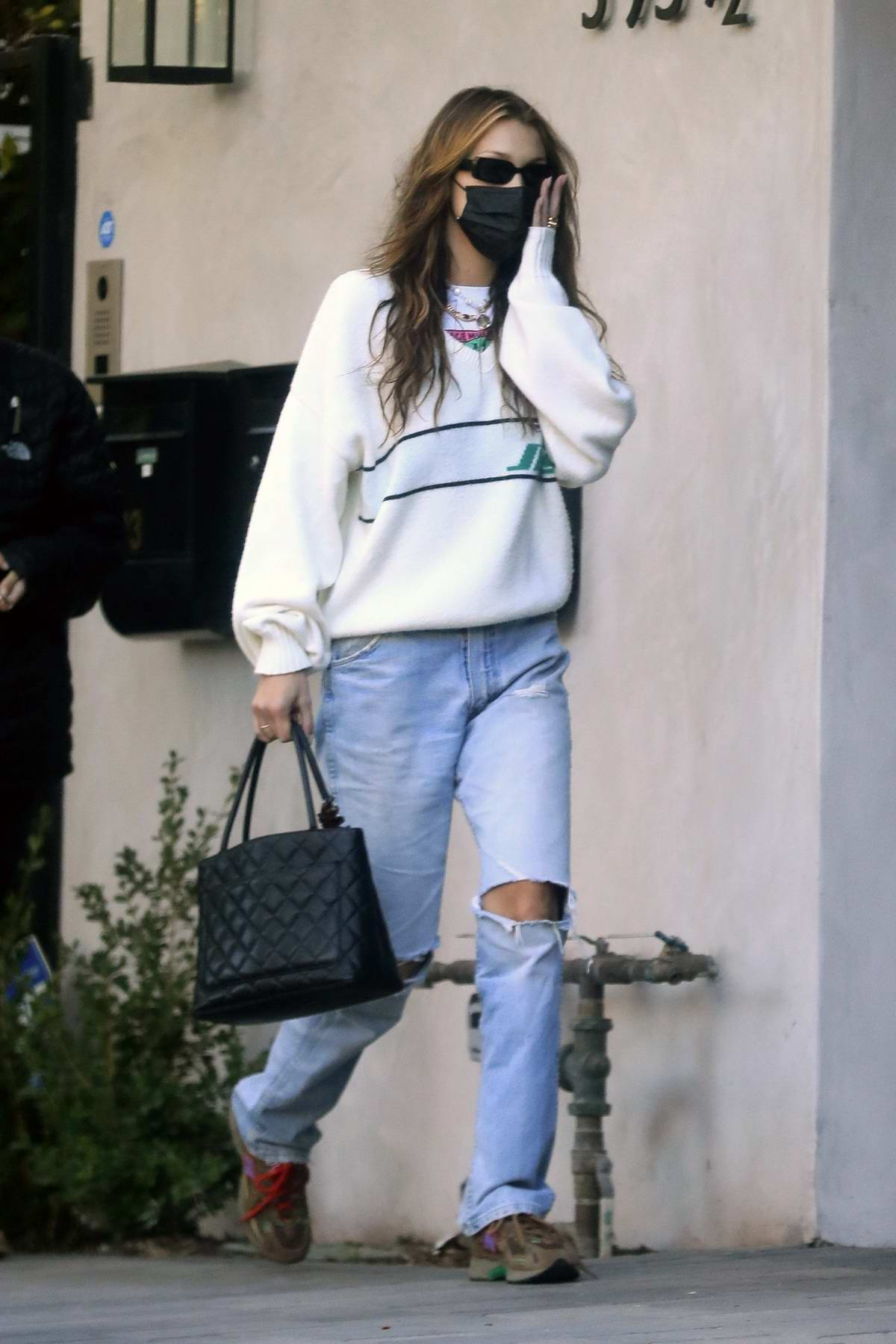 Bella Hadid rocks a pair of ripped jeans as she a studio with her assistant after a meeting in Los Angeles