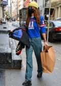 Bella Hadid sports a New York Giant shirt while out on a shopping spree at a local boutique in New York City
