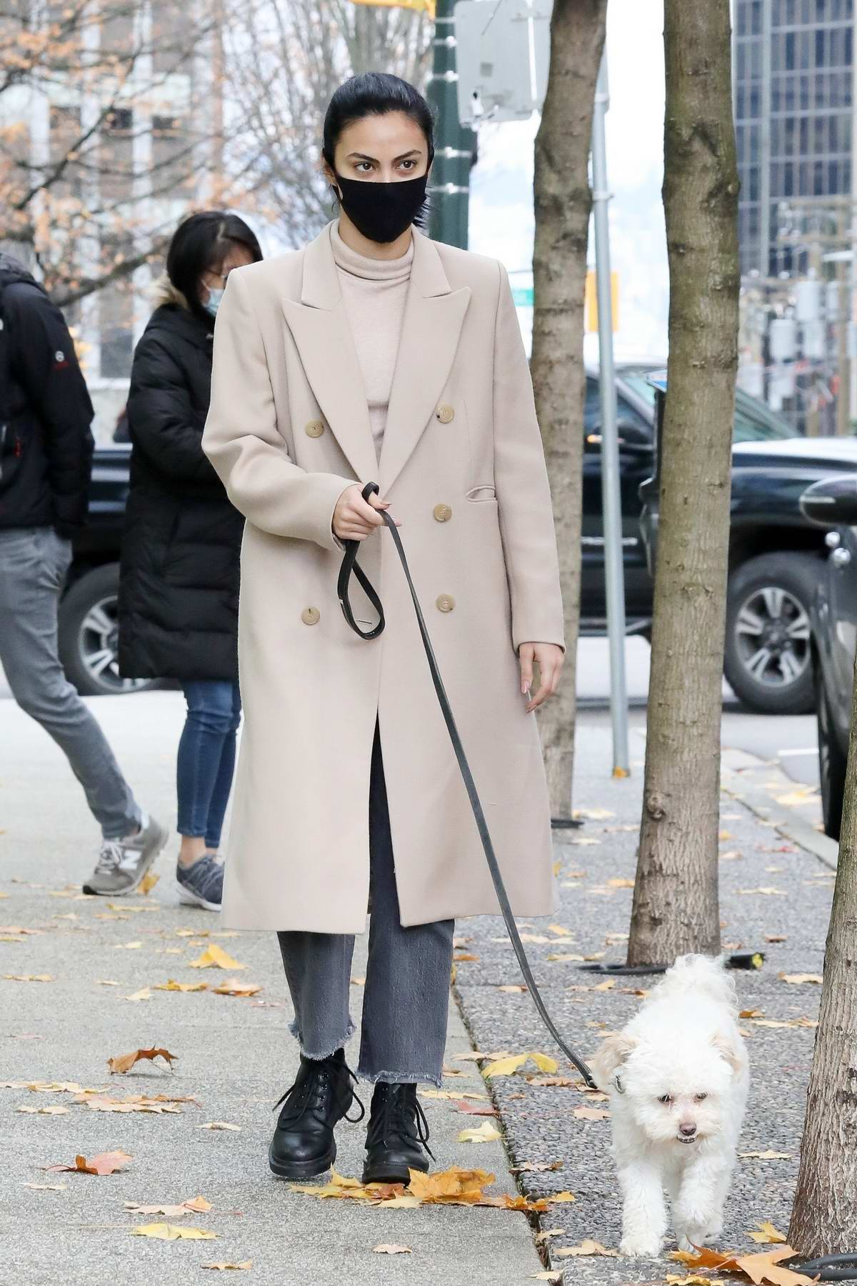 Camila Mendes wears a warm stylish coat to take her dog for a walk in Vancouver, Canada