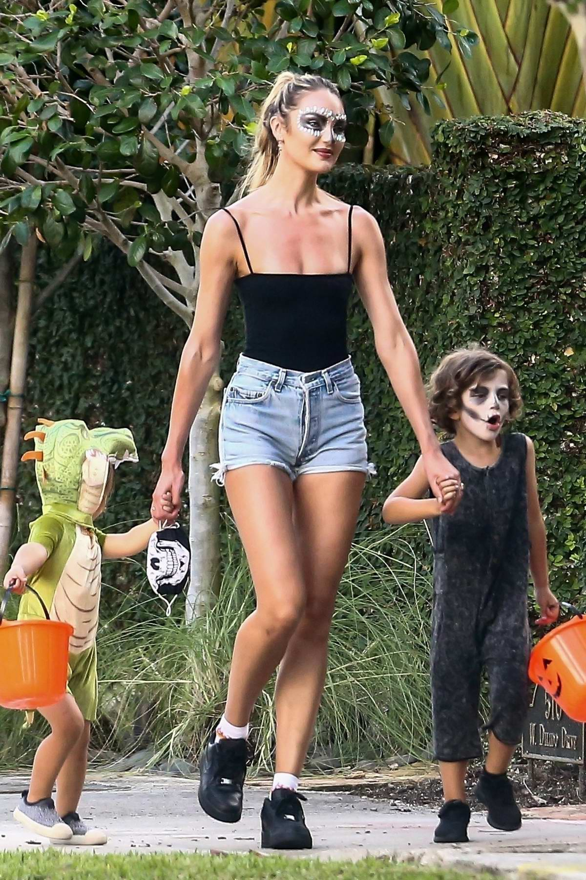 Candice Swanepoel gets into the Halloween spirit with her kids in Miami Beach, Florida