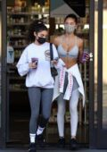 Chantel Jeffries and Jocelyn Chew grab juice drinks at EarthBar after their workout at Dogpound in West Hollywood, California