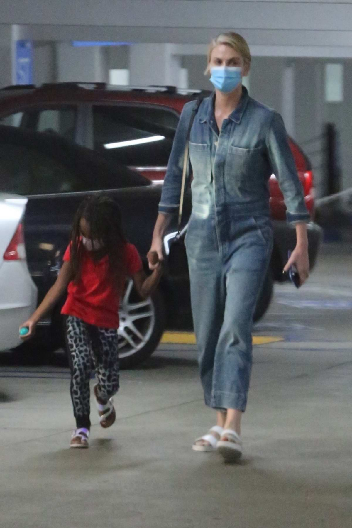 Charlize Theron visits the hospital with her daughter in Los Angeles