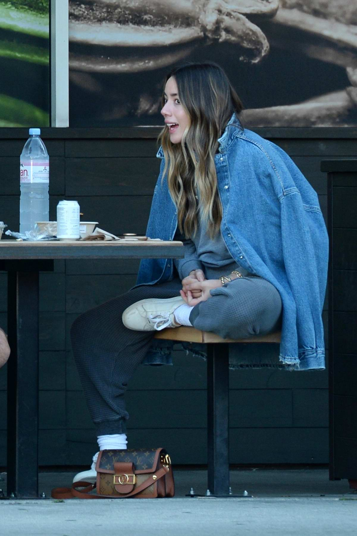 Chloe Bennet seen having alfresco lunch with a friend at Erewhon in Los Angeles
