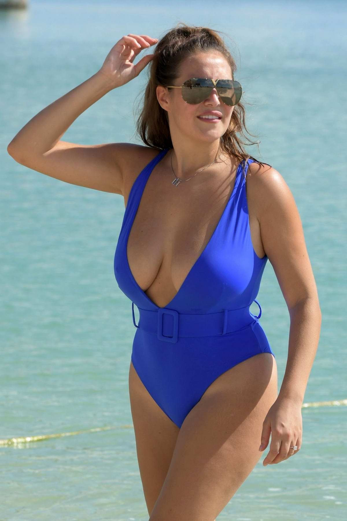 Chloe Goodman seen wearing a blue swimsuit while on her holidays in Dubai, UAE