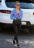 Chrishell Stause sports black leggings and a blue jacket while out running errands in Los Angeles