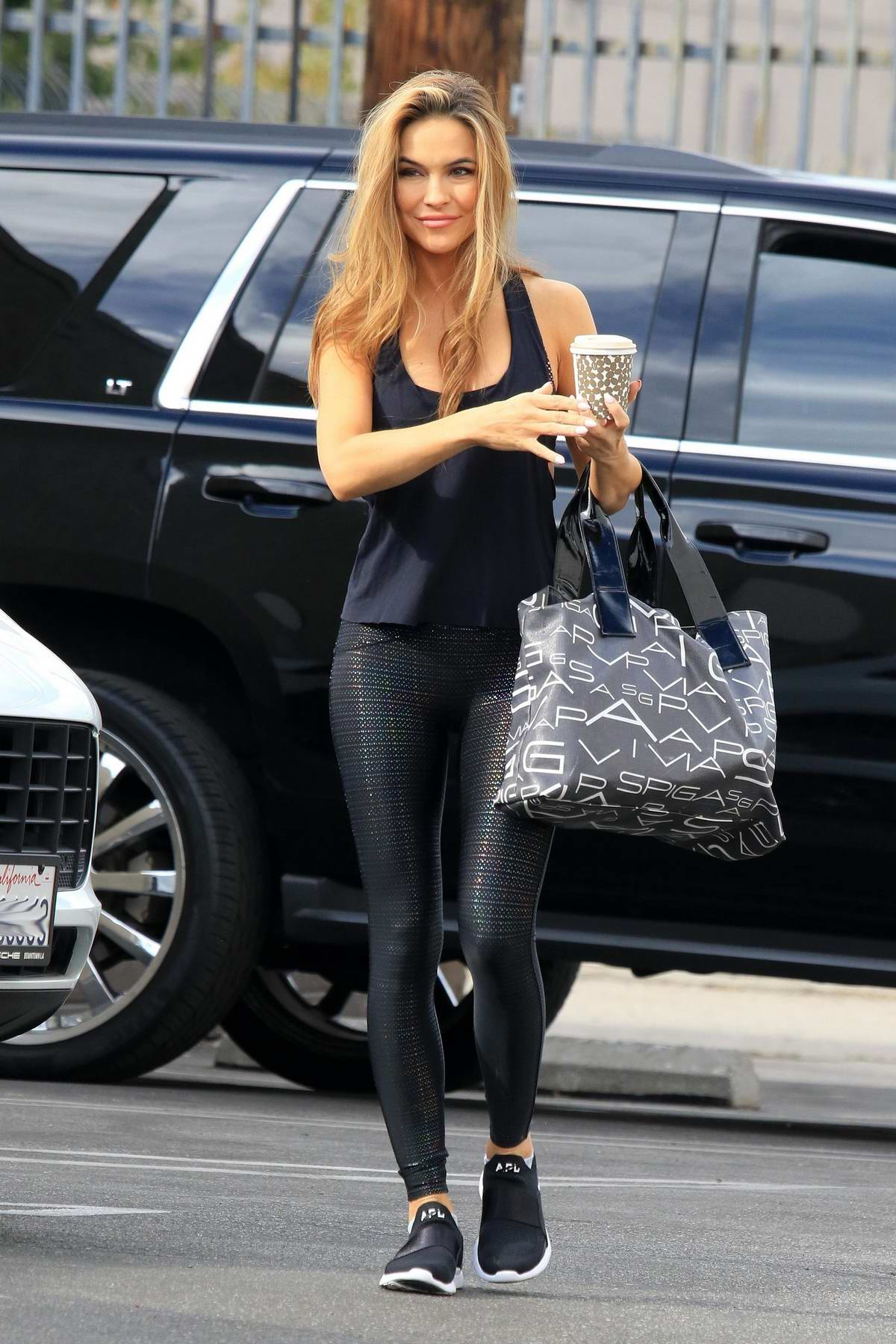 Chrishell Stause sports tank top and leggings as she heads into the DWTS studio for dance pratice in Los Angeles