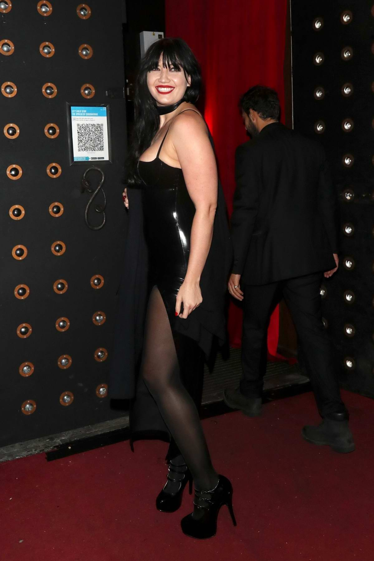 Daisy Lowe dons a black latex dress while arriving for an All Star Cabaret Halloween night at Proud Embankment in London, UK