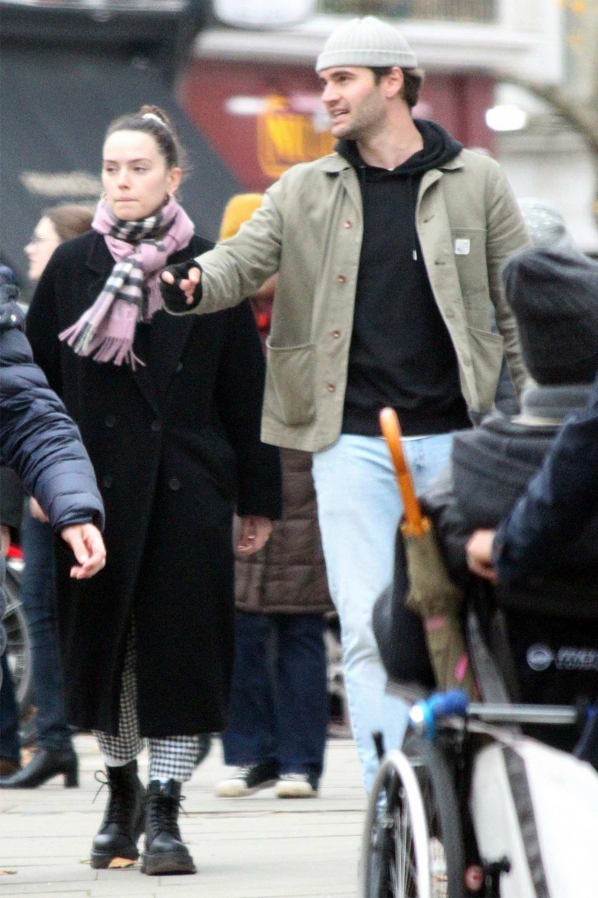 Daisy Ridley and Tom Bateman spotted out on a stroll in Primrose Hill, London, UK