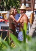 Delilah Hamlin spotted in a green bikini while packing on some PDA with Eyal Booker while on vacation in Tulum, Mexico