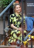 Dianna Agron looks lovely in a floral print dress as she meets up with friends in New York City