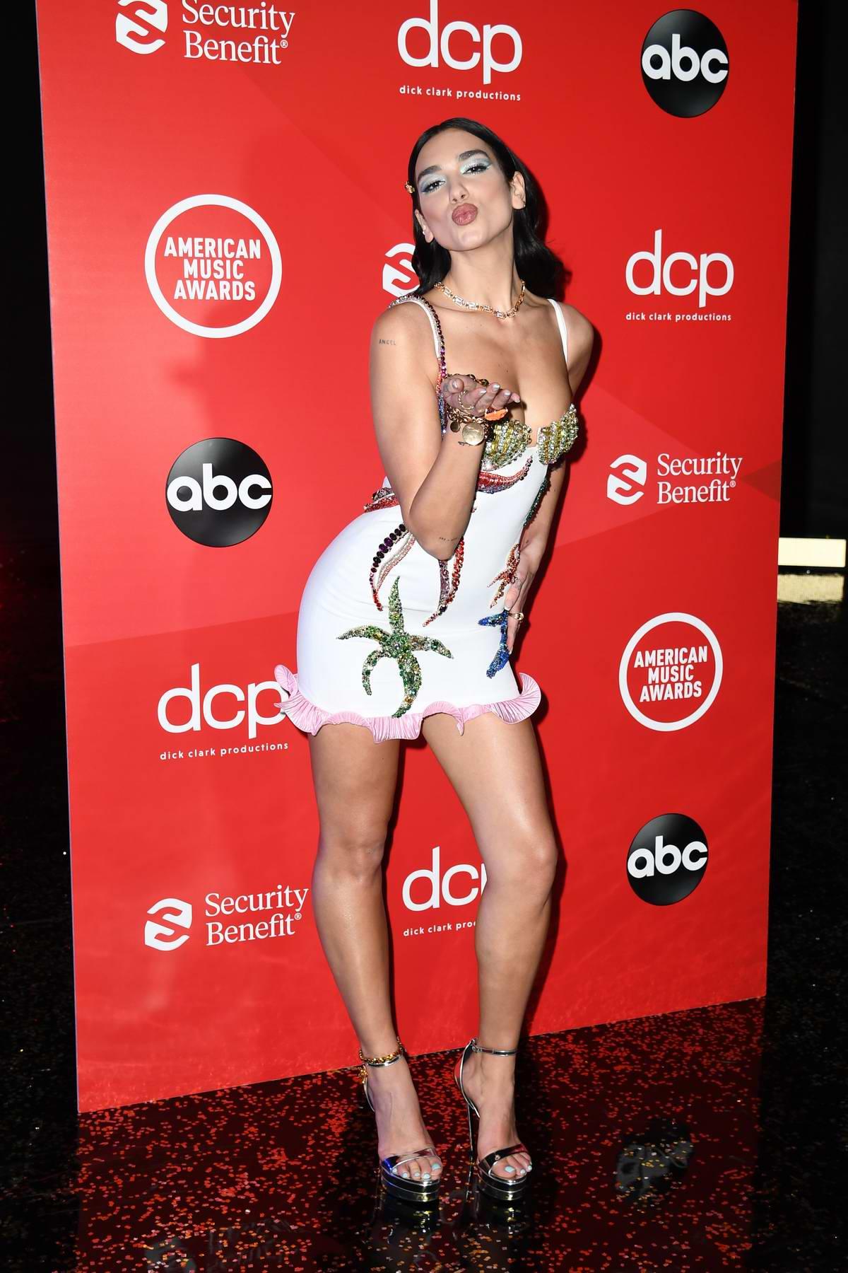 Dua Lipa attends the 2020 American Music Awards in London, UK