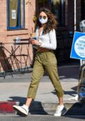Eiza Gonzalez flashes her toned midriff in a cropped cardigan while making a coffee run in West Hollywood, California