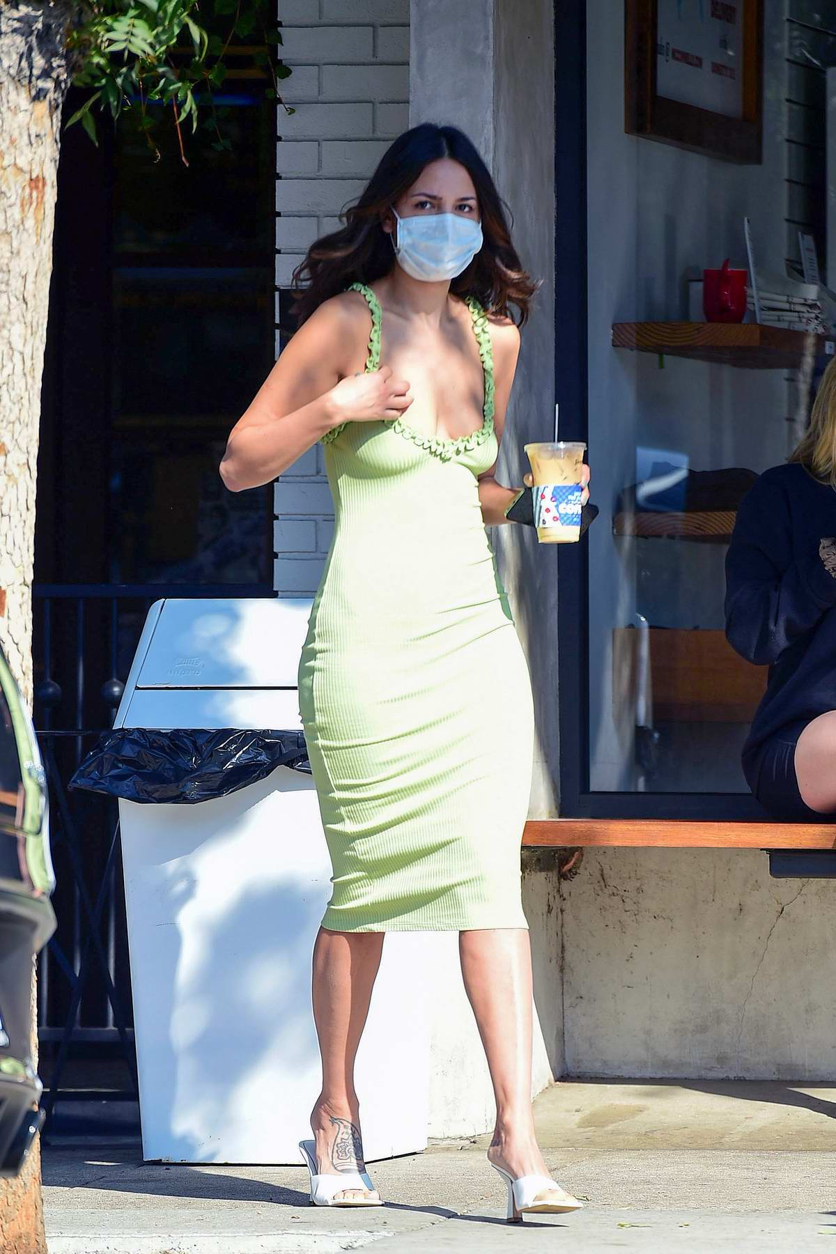 Eiza Gonzalez looks gorgeous in a form-fitting green dress while making a coffee run in West Hollywood, California