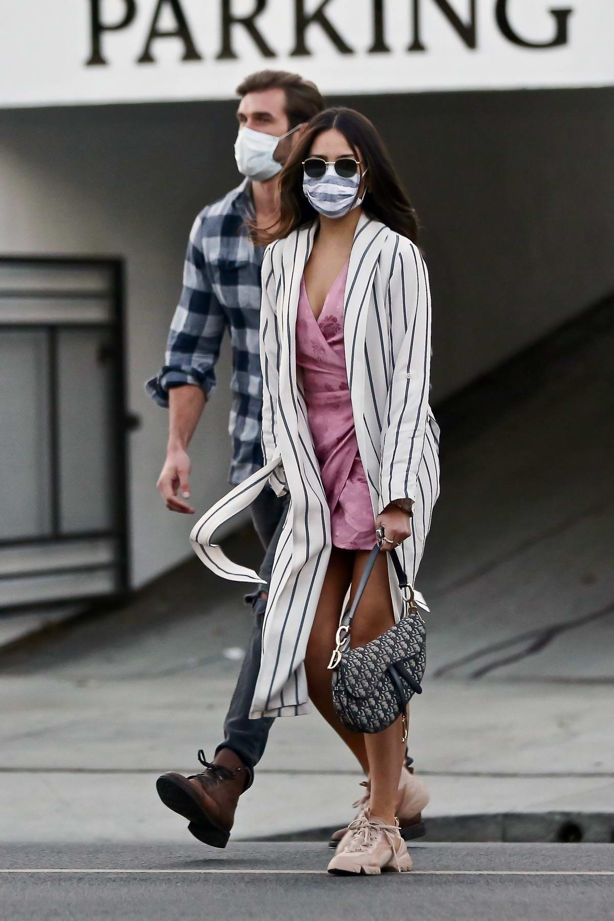 Eiza Gonzalez looks pretty in a pink wrap dress while out on a date with mystery man in Los Angeles