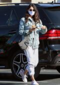 Eiza Gonzalez rocks a denim jacket and sweatpants during her morning coffee run in Los Angeles