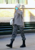 Elsa Hosk steps out looking cozy in an oversized grey sweater in New York City