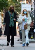 Elsa Hosk wears a white fur coat and tie-dye pants during an iced coffee run with Tom Daly in New York City