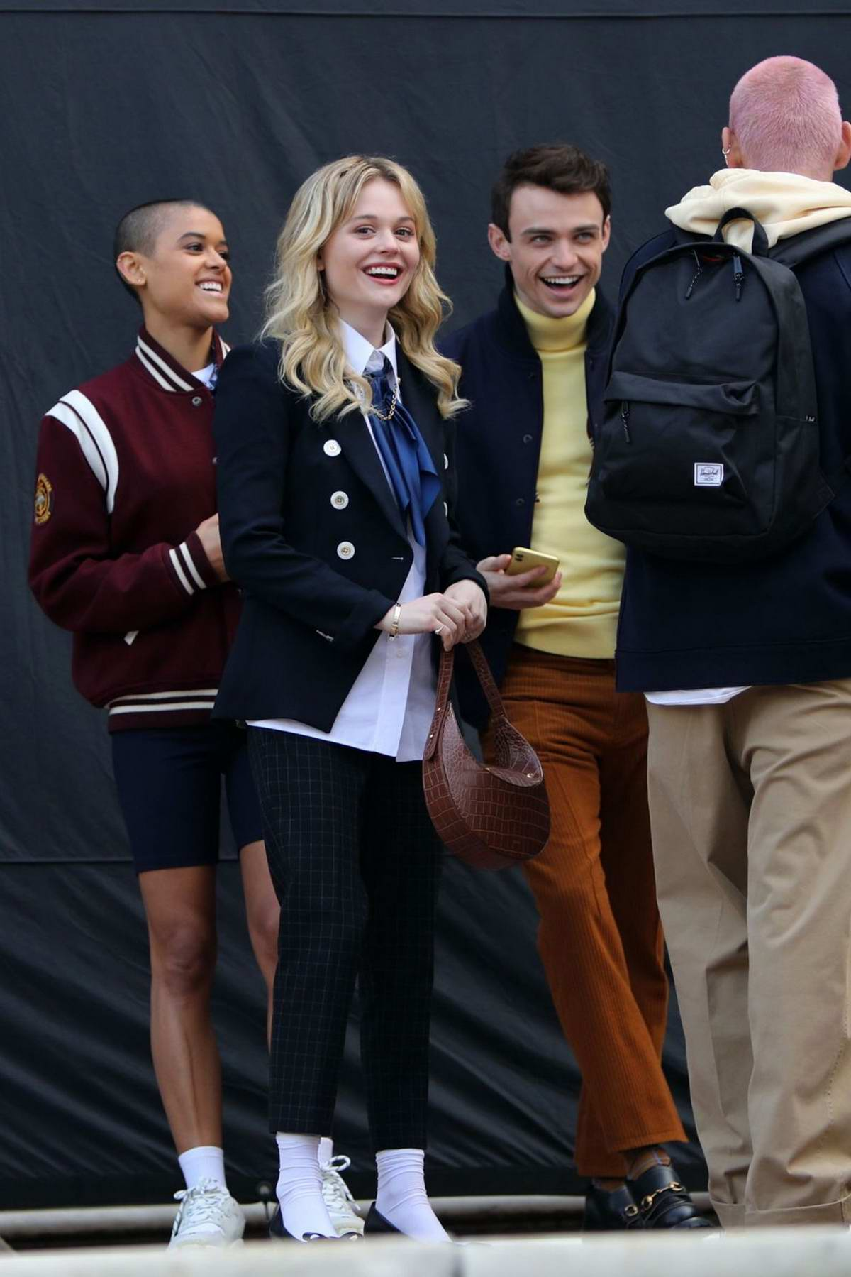 Emily Alyn Lind is all smiles while filming 'Gossip Girl' in New York
