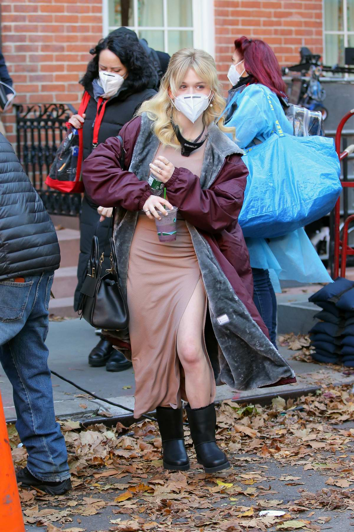 Emily Alyn Lind seen wearing a face shield and a face mask while on the set of 'Gossip Girl' in New York City