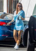 Emily Ratajkowski shows her growing baby bump in a form-fitting blue minidress while shopping at the flower market in Los Angeles
