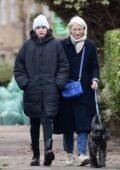 Emma Corrin dons all-black winterwear as she enjoys a stroll in Belsize Park in North London, UK