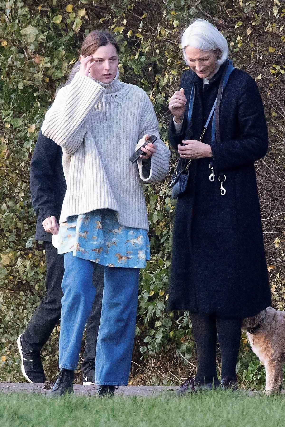 Emma Corrin wears an oversized sweater as she steps out to walk her dog at a local park in London, UK