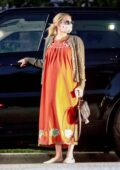 Emma Roberts dons a maxi orange dress as she visits a friend in Los Feliz, California