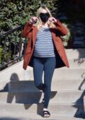 Emma Roberts shows her baby bump in a striped tee and leggings while running some errands in Los Angeles
