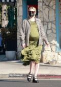 Emma Roberts shows off her growing baby bump in a classy outfit as she goes shopping with her mom in Los Angeles