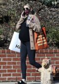 Emma Roberts wears a black tee and leggings while out for some Christmas shopping in Los Angeles