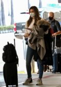 Erin Andrews seen wearing white sweatshirt and skinny jeans as she arrives at LAX in Los Angeles