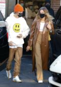Hailey Bieber and Justin Bieber slip out the back exit as they depart after lunch at Il Pastaio in Beverly Hills, California