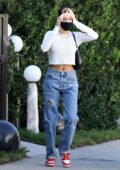 Hailey Bieber flashes her midriff while visiting some friends with Justin Bieber in Beverly Hills, California