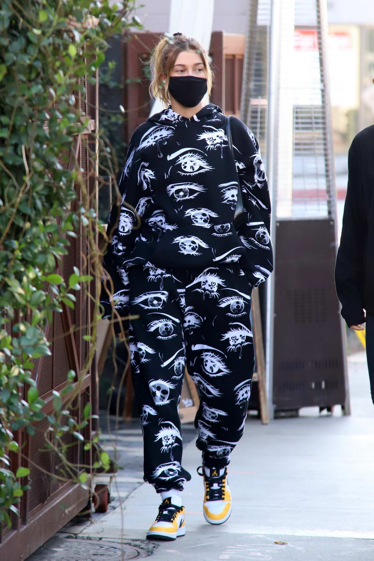Hailey Bieber looks casually chic in printed sweats with Nike dunk sneakers while out for lunch in West Hollywood, California
