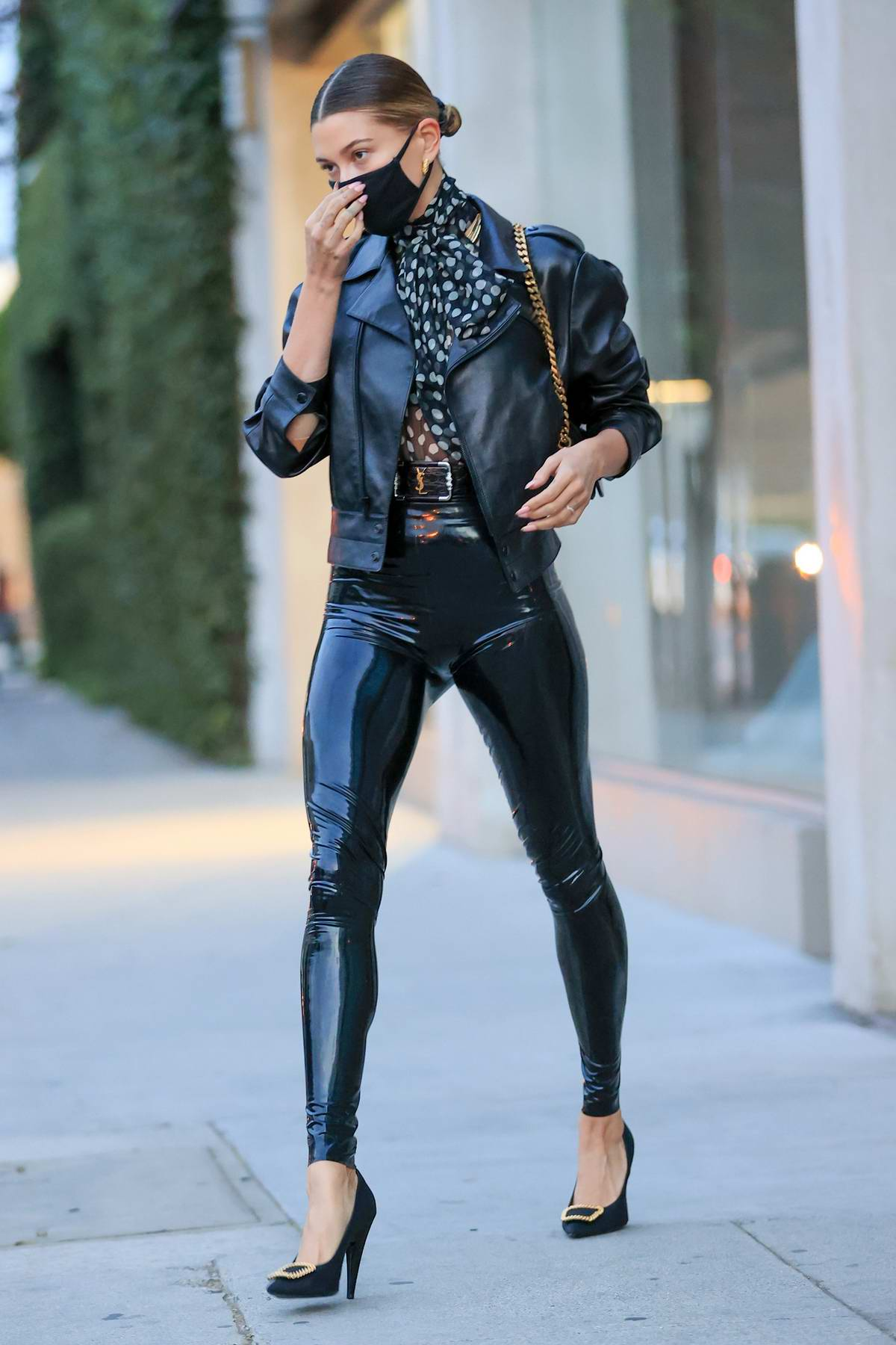 Hailey Bieber puts on a stylish display in a black latex YSL outfit while visiting stylist Maeve Reilly's office in Los Angeles