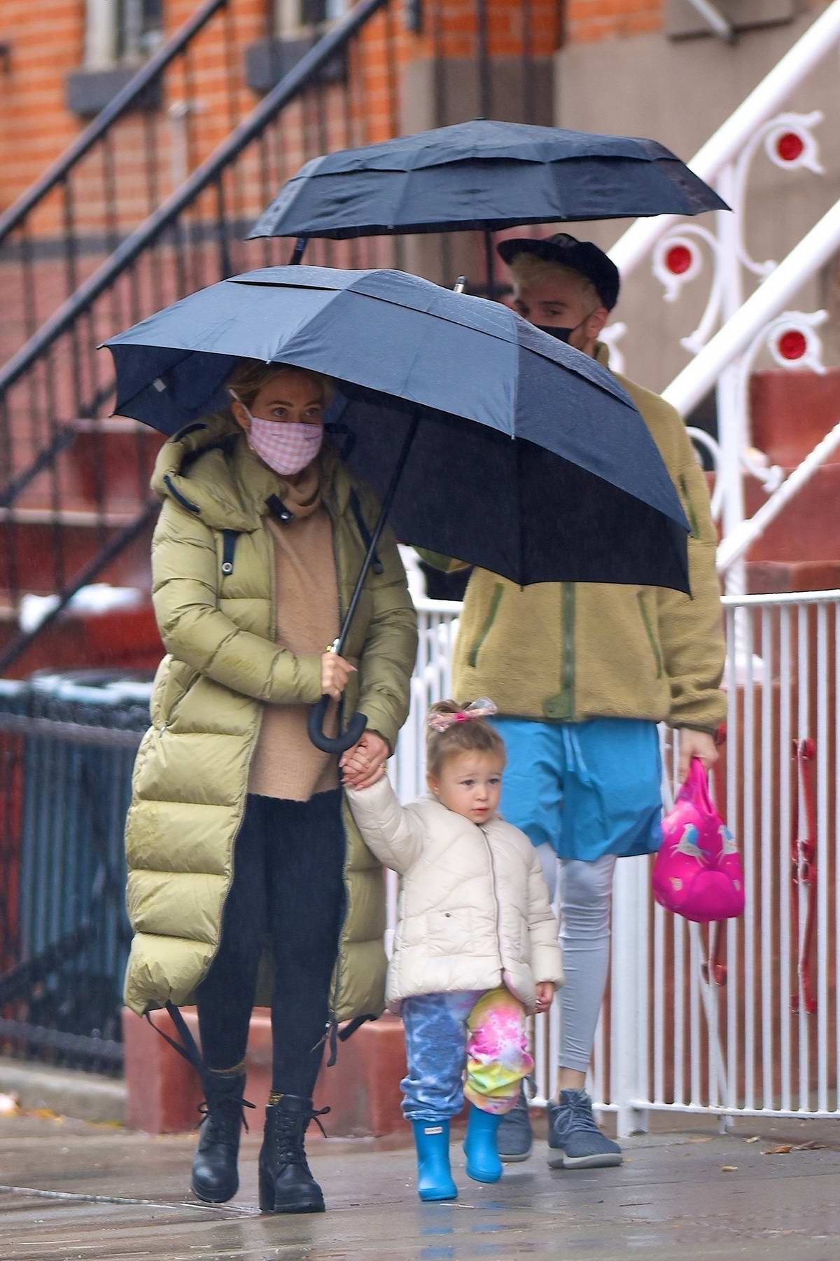 Hilary Duff bundles up in a puffer jacket as she takes her family out for breakfast in New York City