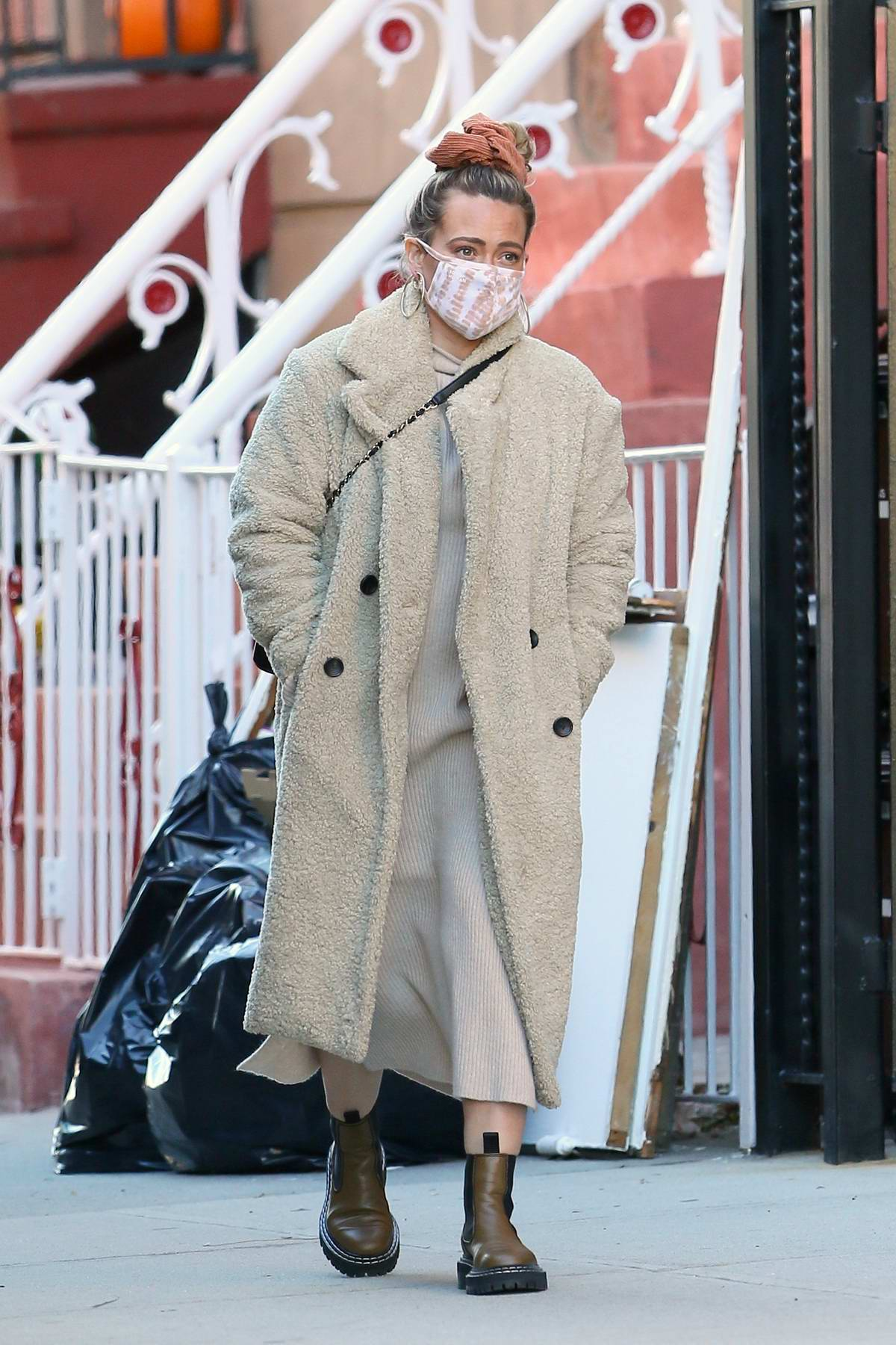 Hilary Duff bundles up in a teddy coat as she steps out on a chilly day in New York City