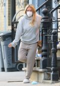 Hilary Duff looks cozy in her sweats as she steps out to pick up delivered food in New York City
