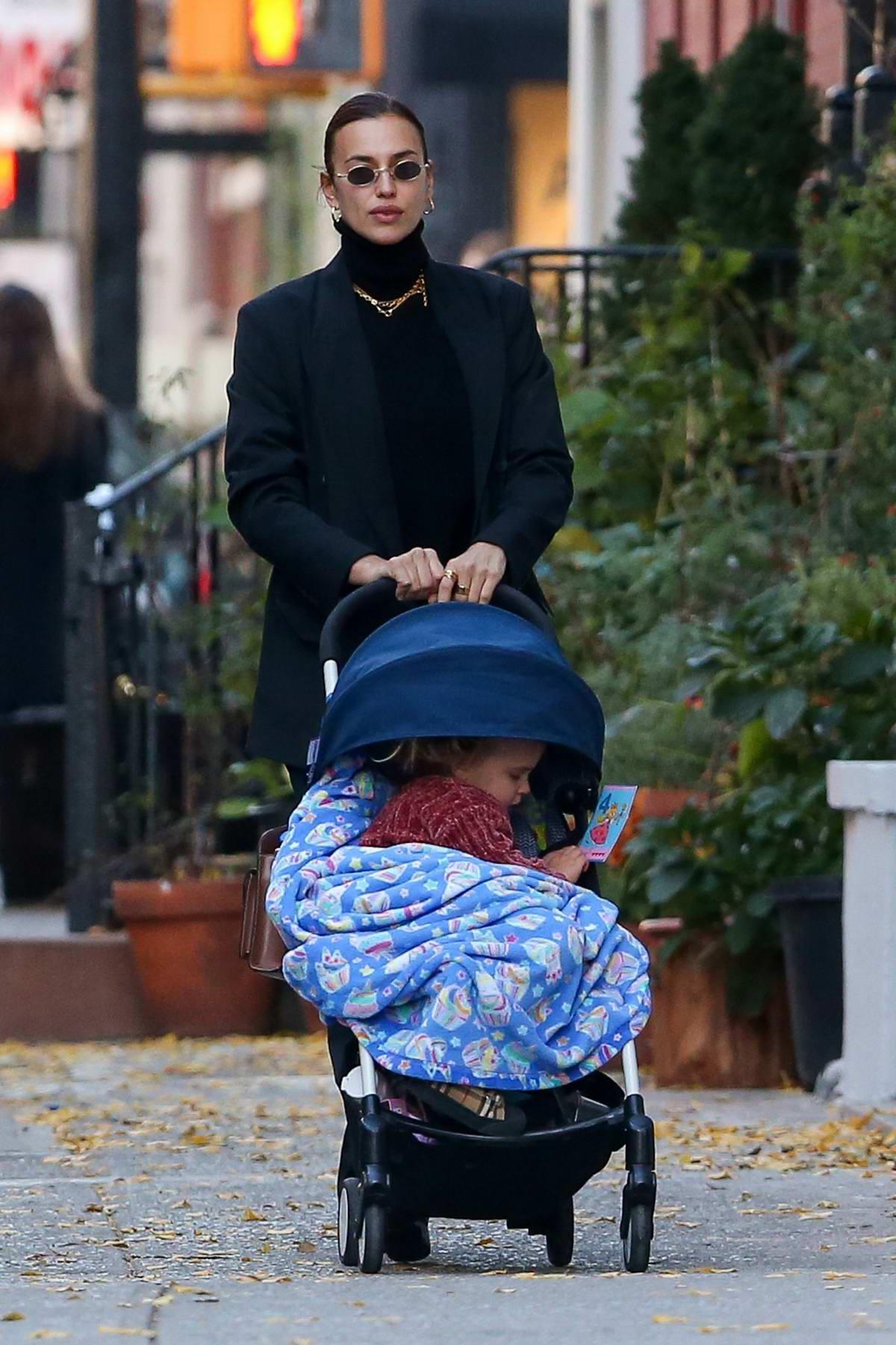 Irina Shayk looks sleek in all-black while enjoying a walk with her daughter in New York City