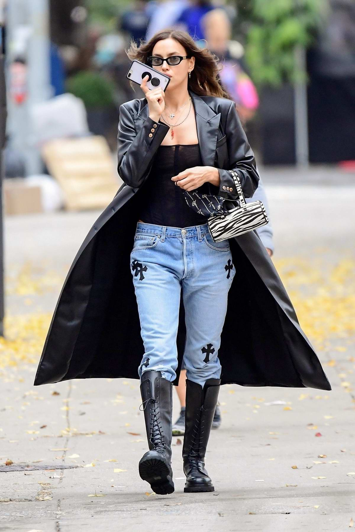 Irina Shayk looks stylish in a black overcoat and denim while out in New York City