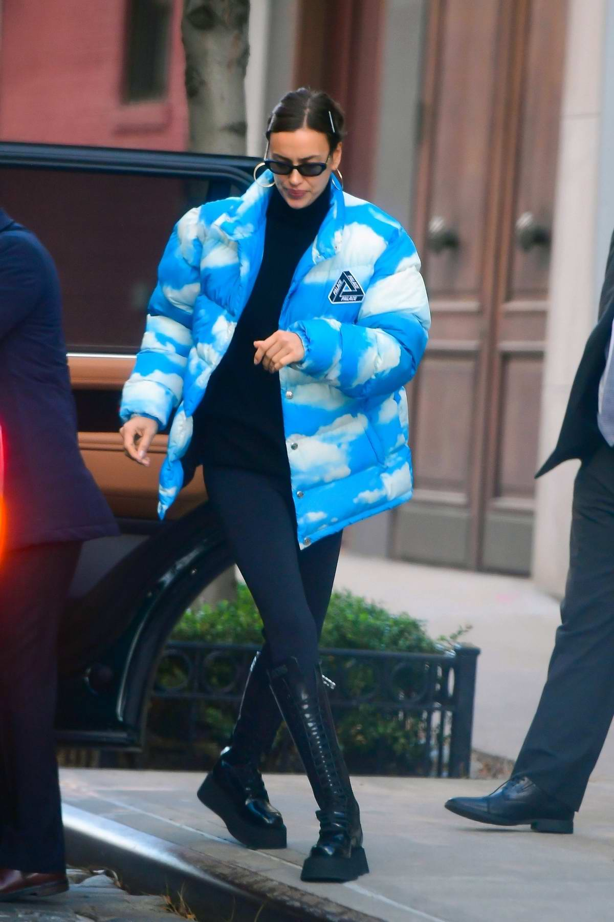 Irina Shayk rocks a Moschino cloud print puffer jacket as she steps out with her daughter in New York City