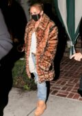 Jennifer Lopez dons an animal print Coach coat with ripped denim for dinner at San Vicente Bungalows in West Hollywood, California