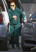 Jennifer Lopez looks cool in green sweats and Nike sneakers while arriving at the recording studio in Beverly Hills, California