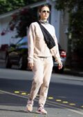 Jessica Alba goes casual chic in pink sweats during a morning walk around her neighborhood in Los Angeles