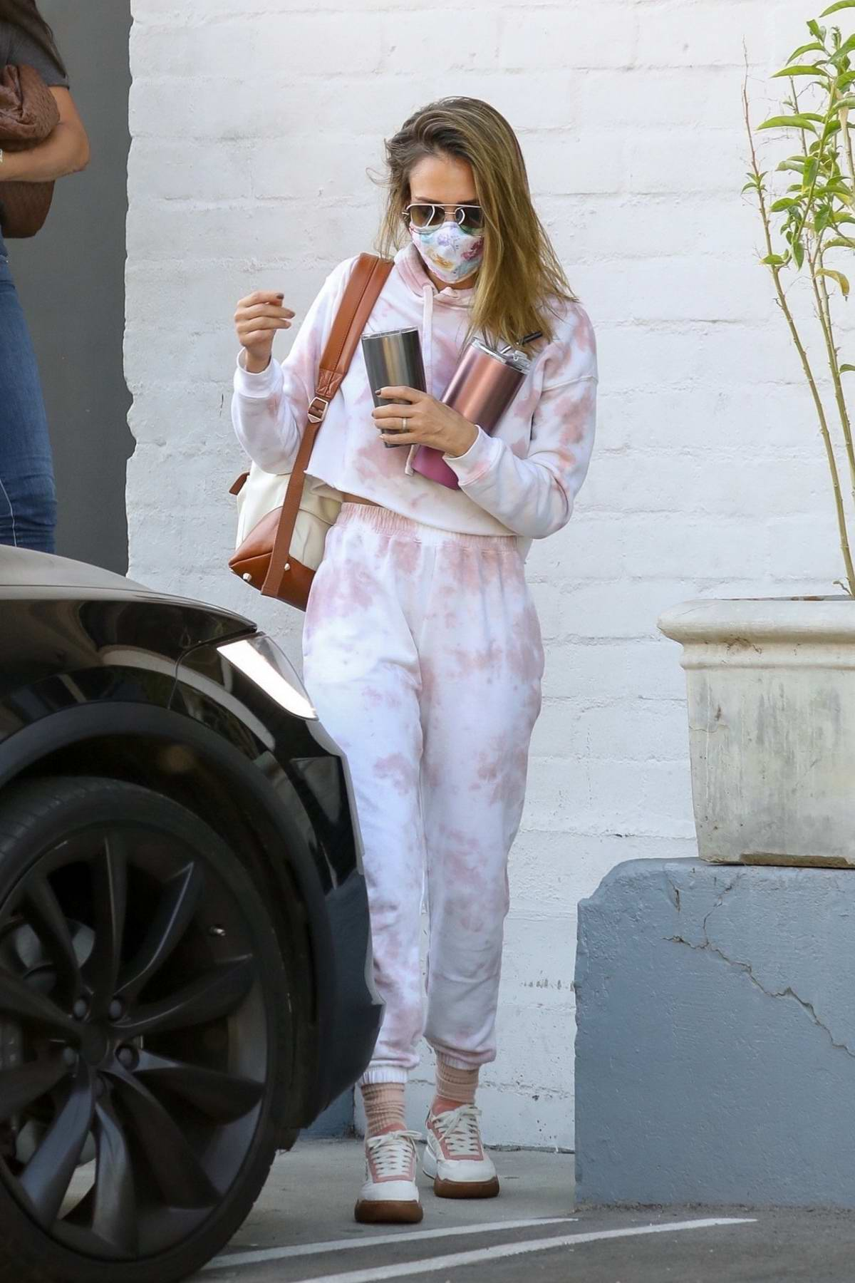 Jessica Alba looks cool in tie-dye sweats as she visits a hair salon before picking up a juice from Kreation in Los Angeles