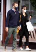 Jordana Brewster and boyfriend Mason Morfit hold hands as they step for coffee in Brentwood, California