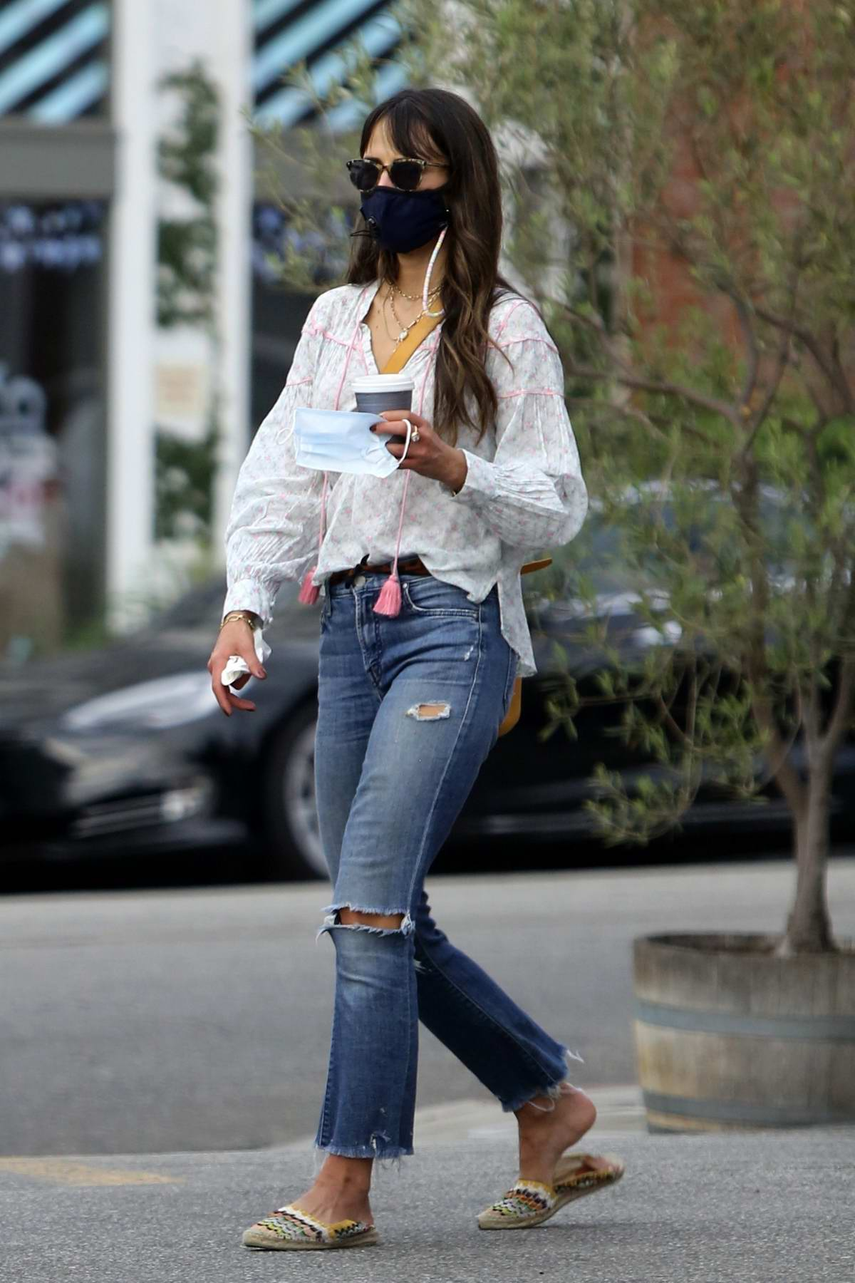 Jordana Brewster wears ripped jeans as she steps out for coffee in Brentwood, California