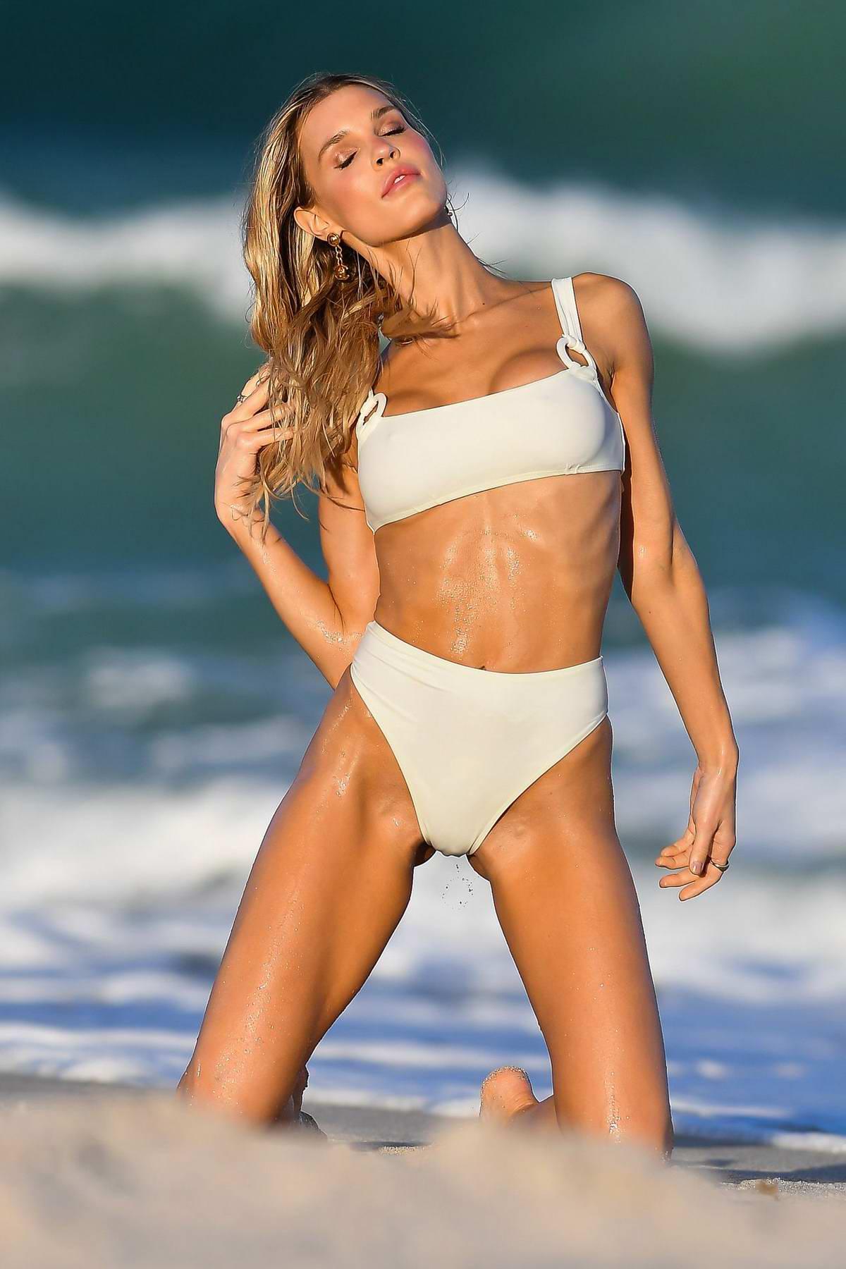 joy corrigan looks incredible in a white bikini during a ...